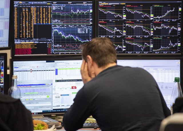 28 February 2020, Hessen, Frankfurt_Main: An exchange trader looks at his monitors at the Frankfurt Stock Exchange. Key stock markets around the world took a pummeling on Friday as investors made clear the level of concern surrounding the financial impact