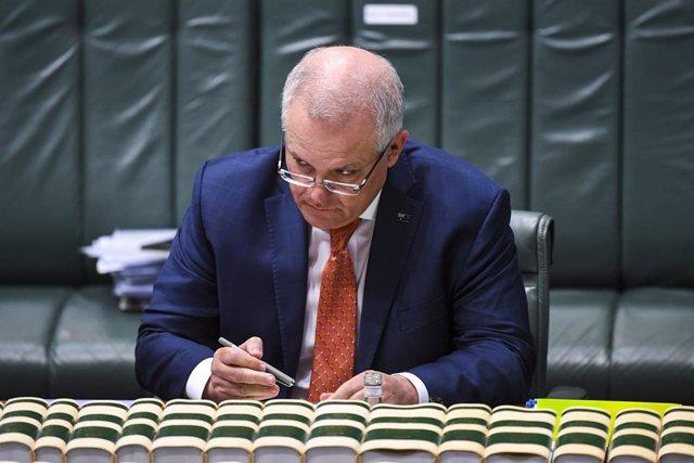 Australian Prime Minister Scott Morrison reacts during House of Representatives