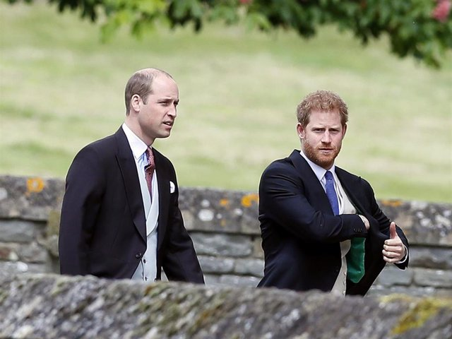 Britain's Prince William, left, and his brother Prince Harry arrive for the wedding of Pippa Middleton and James Matthews at St Mark's Church on May 20, 2017 in Englefield.