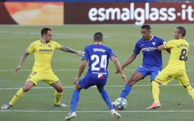 Fútbol/Primera.- (Crónica) El Sevilla frena al Villarreal y se asienta en 'Champ