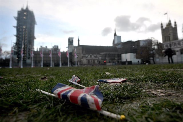 01 February 2020, England, London: Union flags left discarded on the mud and grass at Parliament Square, following Brexit celebrations after the UK left the European Union on Friday, ending 47 years of close and sometimes uncomfortable ties to Brussels. P