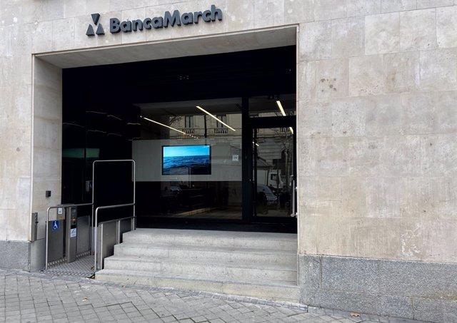 Puerta principal de un local de Banca March en Madrid (España), a 13 de febrero de 2020.