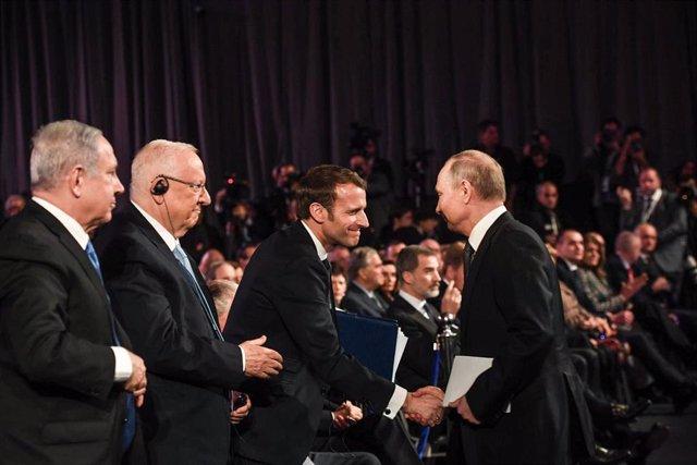 Emmanuel Macron y Vladimir Putin