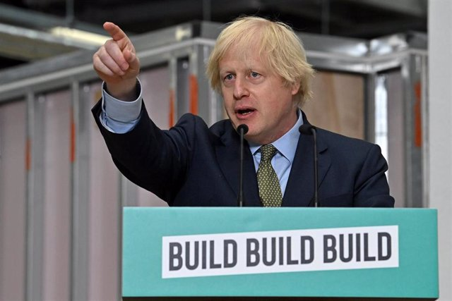 30 June 2020, England, Dudley: UK Prime Minister Boris Johnson delivers a speech during a visit to Dudley College of Technology. Johnson is expected to announce a 5 billion pounds (6.15 billion dollars)  deal for infrastructure projects to help Britain's