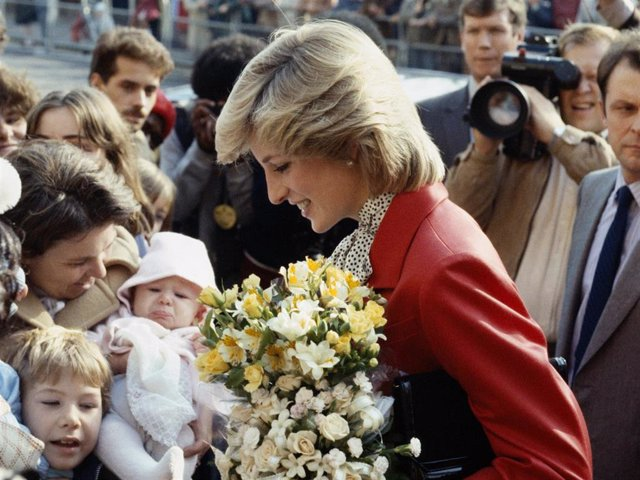Princess Diana wearing a Jasper Conran suit during a visit to a community centre in Brixton, October 1983.