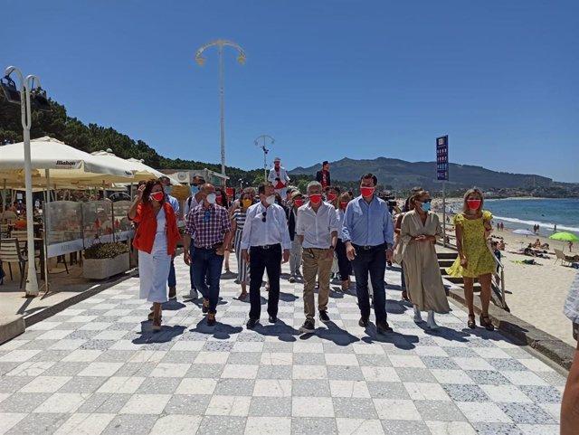 El ministro del Interior, Fernando Grande Marlaska, junto al alcalde de Vigo, Abal Caballero, y el candidato del PSdeG a la Presidencia de la Xunta, Gonzalo Caballero