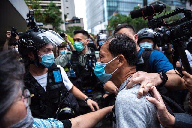 China.- El jefe de la oficina de Pekín en Hong Kong promete que sus agentes no v
