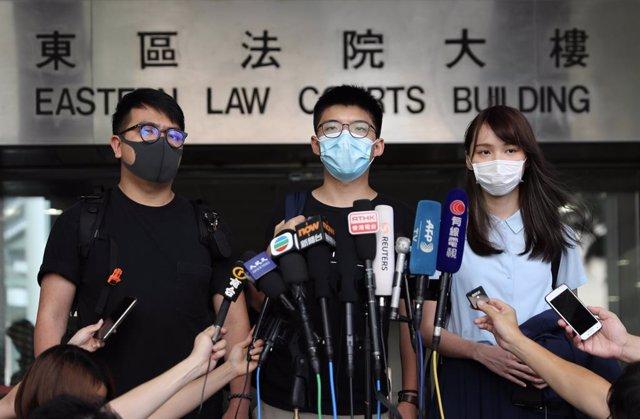 Three pro-democracy activists trail in Hong Kong