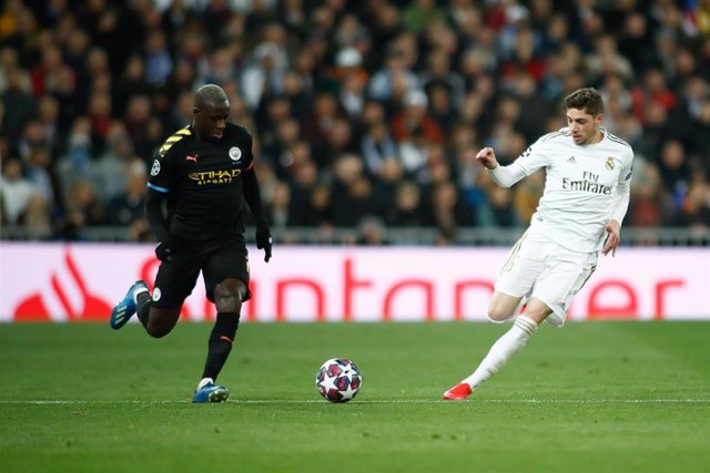 Benjamin Mendy of Manchester City and Federico Valverde of Real Madrid in action during the UEFA Champions League football match played between Real Madrid and Manchester City at Santiago Bernabeu stadium on January 26, 2020 in Madrid, Spain.
