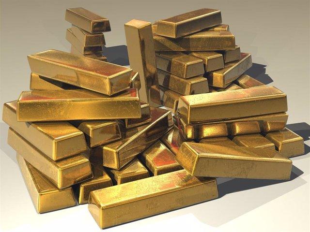 Imagen de recursos de varios lingotes de oro.