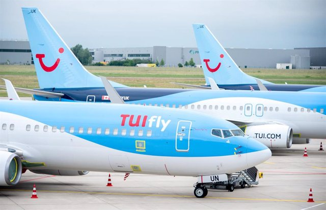 FILED - 15 June 2020, Lower Saxony, Langenhagen: Aircraft belonging to the airline TUIfly park at Hannover Airport. Photo: Hauke-Christian Dittrich/dpa