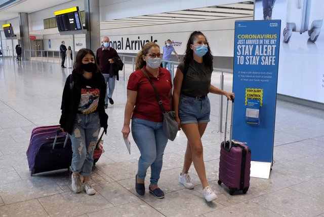 Passengers on a flight from Madrid arrive at Heathrow Airport