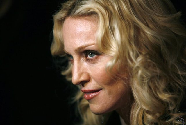 """FILED - 13 February 2008, Berlin: US pop star Madonna arrives to the premiere of her film """"Filth and Wisdom"""". Madonna cancelled the final two dates of her Madame X tour due to the coronavirus outbreak. Photo: Jan Woitas/dpa"""