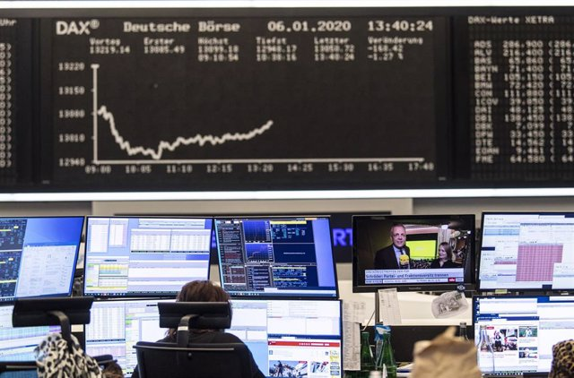 06 January 2020, Hessen, Frankfurt_Main: A stock trader works on the Frankfurt Stock Exchange, as the conflict between the USA and Iran has further unsettled investors in the German stock market. The Dax temporarily slipped below the 13,000 mark, a low fo