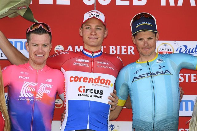 21 April 2019, Netherlands, Berg En Terblijt: Australian cyclist Simon Clarke of EF Education First Pro Cycling (L-R), Dutch cyclist Mathieu Van der Poel of Corendon-Circus and Danish cyclist Jakob Fuglsang of Astana Pro Team celebrate on the podium