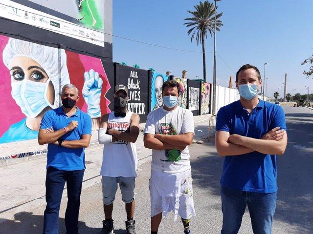Mural que están realizando en la barriada de Sacaba de Málaga para simbolizar el valor de superación