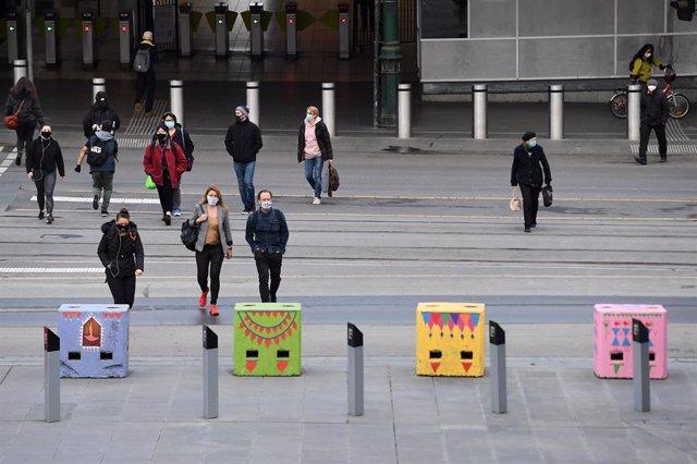 Ciudadanos con mascarilla en Melbourne (Australia)