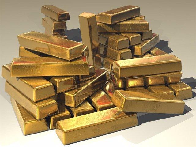 Economía.- El oro no encuentra techo tras romper la barrera de los 2.000 dólares
