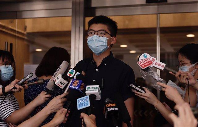 China.- Más de 20 activistas hongkoneses imputados, incluido Joshua Wong, por co