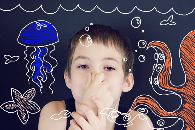 Young Boy Imagination Underwater    Young boy using imagination to pretend he is holding his breath underwater with octopus, fish, jellyfish, and starfish.