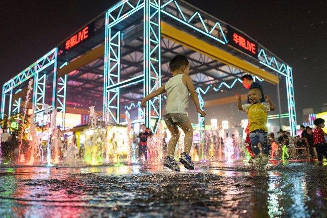 Niños jugando en Pekín