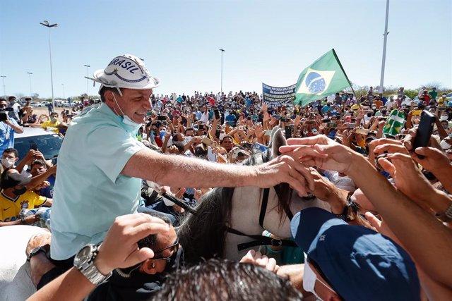 Brasil.- El Congreso de Brasil tumba el veto de Bolsonaro que no obliga a usar m