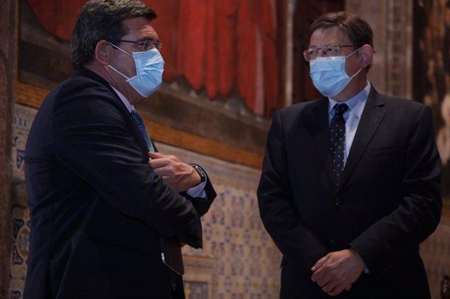 El ministro Jose Luis Escrivá y el president de la Generalitat, Ximo Puig.