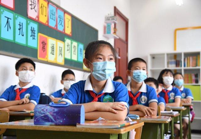Niños chinos en una clase en Pekín