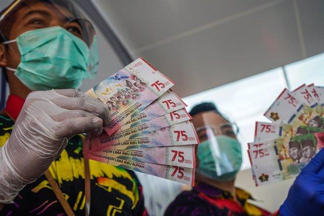 Coronavirus.- Indonesia declara un máximo histórico de nuevos casos, con más de