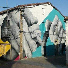 Mural realizado por el artista urbano Caín Ferreras