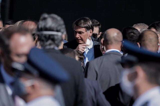 Coronavirus.- Brasil suma 1.200 muertes más y Bolsonaro descarta hacer obligator
