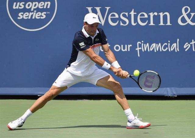 AMPL.- Tenis/US Open.- Bautista y Muguruza se estrenan con victoria en el US Ope