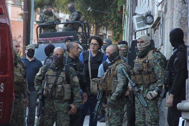 Policía Militar durante un operativo en una favela de Río de Janeiro, en la que un grupo de narcotraficantes se había atrincherado.
