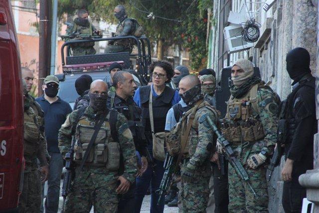 Policía Militar durante un operativo en una favela de Río de Janeiro, en la que