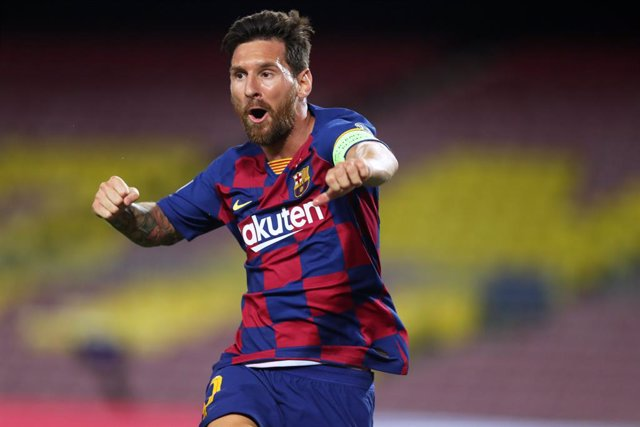 HANDOUT - 08 August 2020, Spain, Barcelona: Barcelona's Lionel Messi celebrates scoring during the UEFA Champions League round of 16 second leg soccer match between Barcelona and Napoli at the Camp Nou Stadium