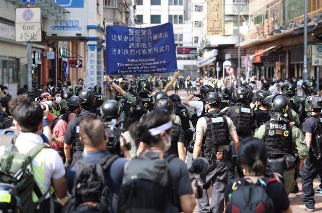 China.- Al menos 90 detenidos en las protestas convocadas en Hong Kong coincidie