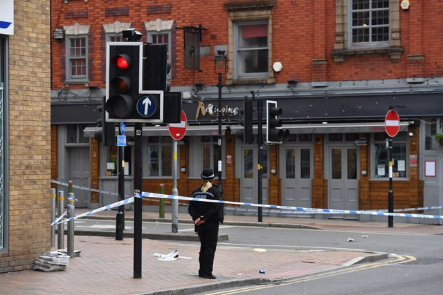 06 September 2020, England, Birmingham: A police officer is seen at a cordon at Irving Street in Birmingham after a number of people were stabbed in the city centre.