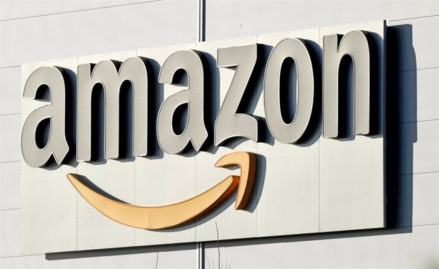 FILED - 17 January 2019, Lower Saxony, Garbsen: A general view of the Amazon logo at a parcel centre of the online retailer. The US online company has won the rights to show Champions League football in Germany from 2021 on its Prime video service, media