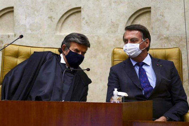 El presidente del Tribunal Supremo de Justicia, Luiz Fux, junto al presidente brasileño, Jair Bolsonaro