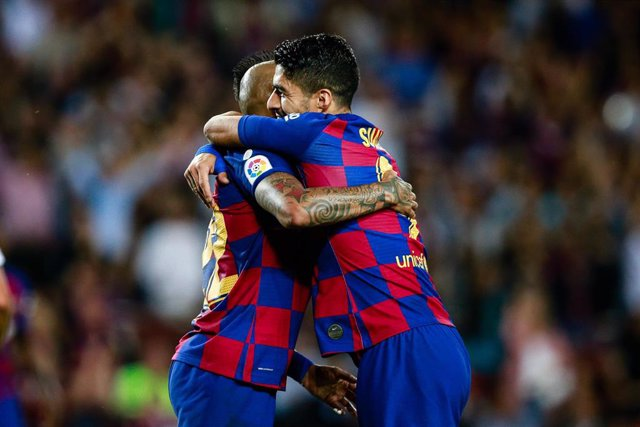 22 Arturo Vidal from Chile of FC Barcelona celebrating his goal with 09 Luis Suarez from Uruguay of FC Barcelona during the La Liga match between FC Barcelona and Sevilla FC in Camp Nou Stadium in Barcelona 06 of October of 2019, Spain.