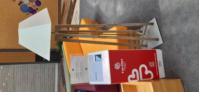 Cepillo digital de Cáritas en el centro comercial Parque Rioja
