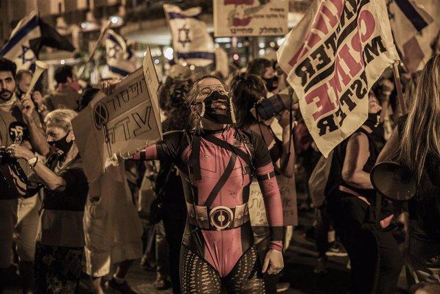 Israel.- El Parlamento israelí restringe las manifestaciones en medio de las pro