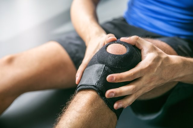 Sports injuries, bandaged knee    Joint pain, knee-joint, man, background