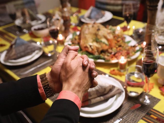 Central American immigrants and their families pray before Thanksgiving dinner on November 24, 2016 in Stamford, Connecticut.