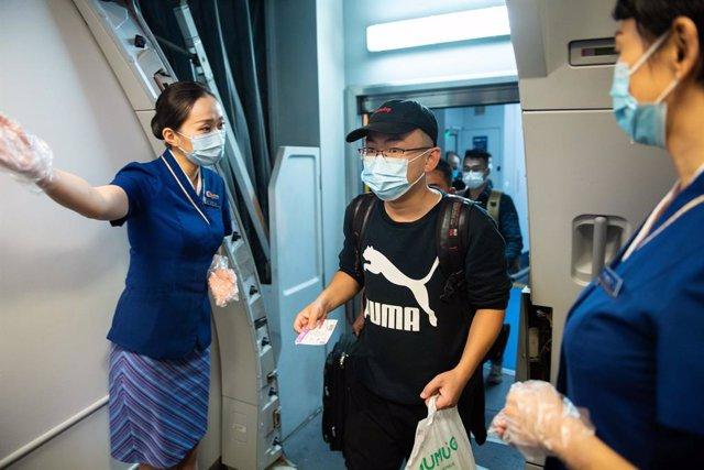 Coronavirus.- China suma otra decena de casos importados y solo uno de transmisi