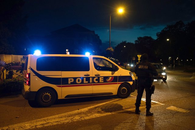16 October 2020, France, Eragny: Police officers investigate a crime scene, where a a history teacher was decapitated by an assailant near Paris, Asuspect who was shot by police is dead. Photo: Abdulmonam Eassa/AFP/dpa