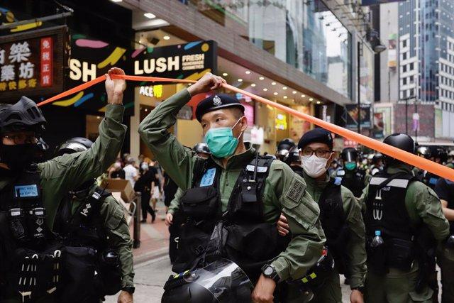 China.- Detenidos tres activistas en Hong Kong, uno de ellos a punto de pedir as