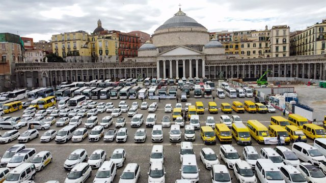 28 October 2020, Italy, Naples: Taxis are parked in the Plebiscito Square during