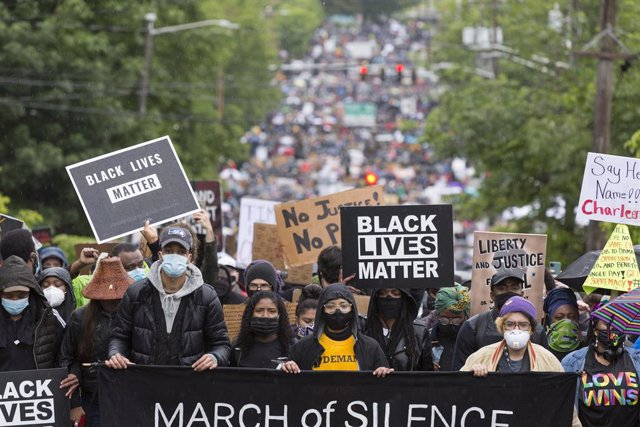 12 June 2020, US, Seattle: People take part in a silent march through Seattle's
