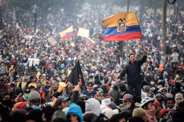 11 October 2019, Ecuador, Quito: People attend an anti-government protest. The S